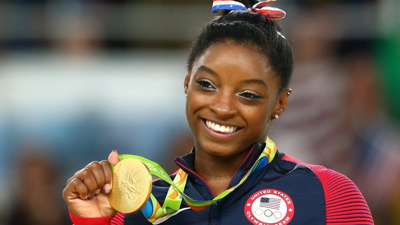 Real life super woman; Simone makes history with 24th Gold Metal